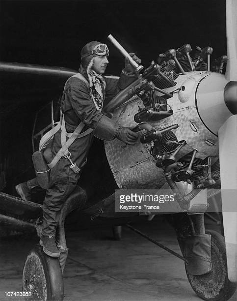 Martin Jensen Looking Over The Motor Of His Bellanca Airplane At Roosevelt Field In New York