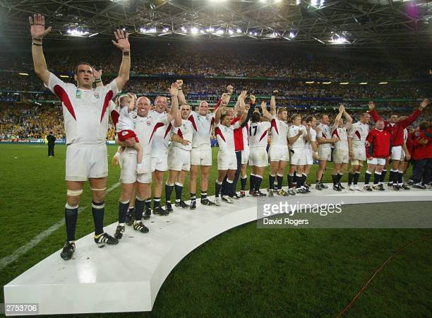 Martin Johnson and the England team stand on the dais to recieve the William Webb Ellis trophy after their victory in the Rugby World Cup Final match...