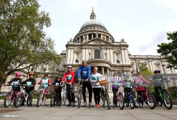 Martin Johnson is joined by Tom Harrison Beth Nimmock and children from Field End Junior School at the Prudential RideLondon Freecycle launch at St...