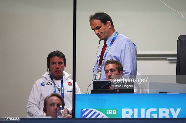 Martin Johnson manager of England looks dejected in the coaches box during quarter final two of the 2011 IRB Rugby World Cup between England and...