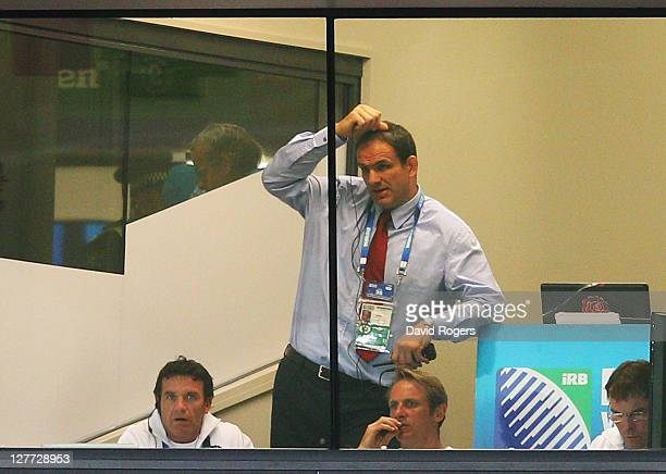 Martin Johnson manager of England scratches his head during the IRB 2011 Rugby World Cup Pool B match between England and Scotland at Eden Park on...