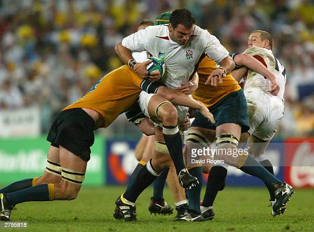 Martin Johnson of England is tackled during the Rugby World Cup Final match between Australia and England at Telstra Stadium November 22 2003 in...