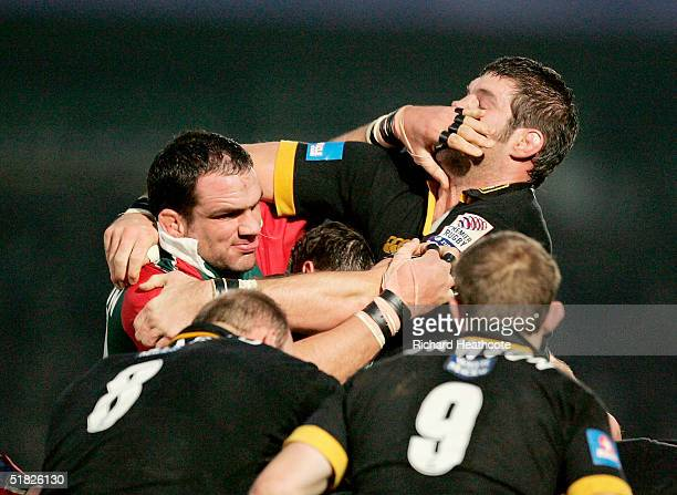 Martin Johnson of Leicester Tigers pushes Simon Shaw of London Wasps during the Heineken Cup match between London Wasps and Leicester Tigers on...