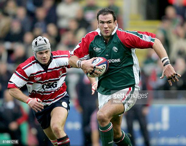 Martin Johnson of Tigers goes past Andy Hazell of Gloucester during the Zurich Premiership match between Leicester Tigers and Gloucester at Welford...