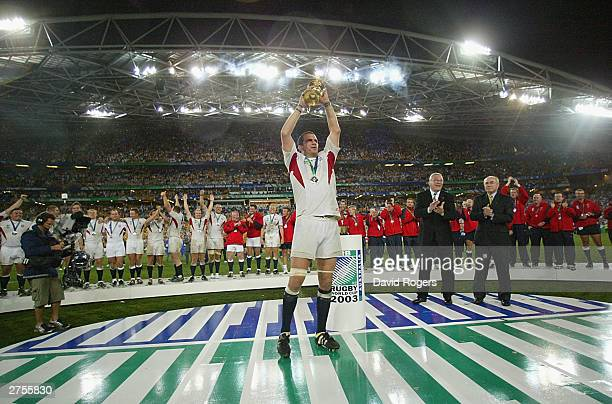 Martin Johnson the captain of England hold aloft the William Webb Ellis trophy after England's victory in the Rugby World Cup Final match between...