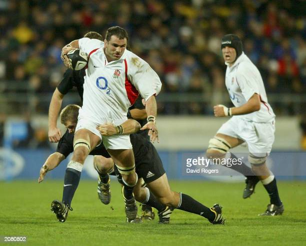Martin Johnson the England captain charges forward with the ball during the Rugby Union International between New Zealand and England on June 14 at...