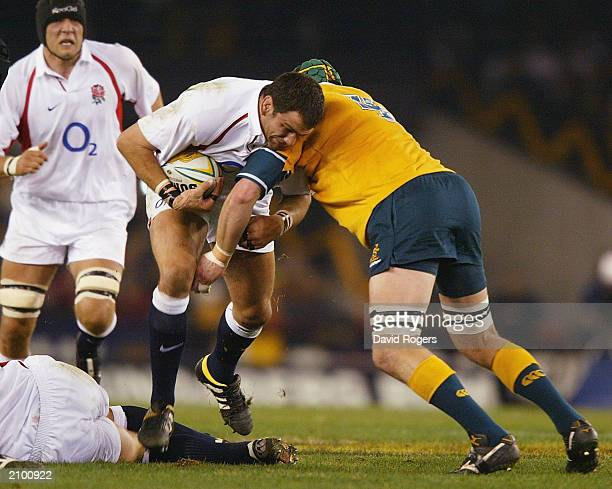 Martin Johnson the England captain is tackled by Nathan Sharpe of Asutralia during the Rugby Union Test Match between Australia v England at The...