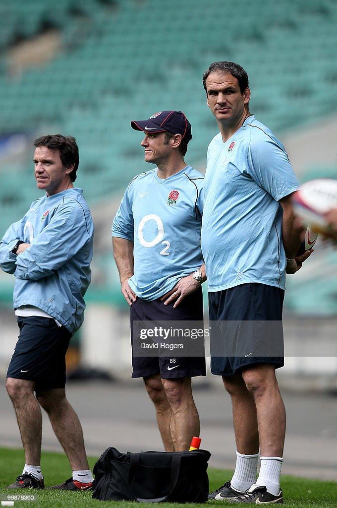Martin Johnson, (R) the England head coach looks on with his assistant coaches Brian Smith and Mike Ford (L) during an England training session held at Twickenham on May 18, 2010 in Twickenham, England.