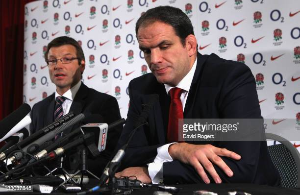 Martin Johnson the England manager announces his resignation as he faces the media watched by RFU director of Elite Rugby Rob Andrew on November 16...