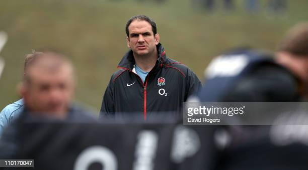 Martin Johnson the England manager looks on during the England training session held at Pennyhill Park Hotel on March 16 2011 in Bagshot England