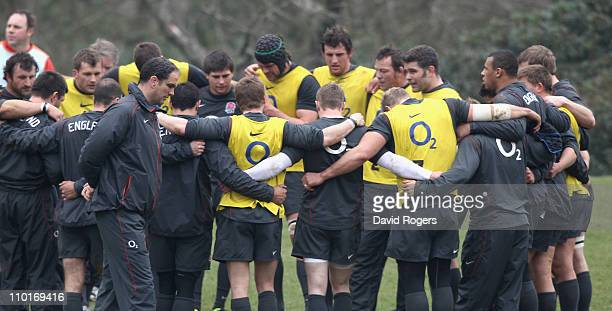 Martin Johnson the England manager walks past his team during the England training session held at Pennyhill Park Hotel on March 16 2011 in Bagshot...