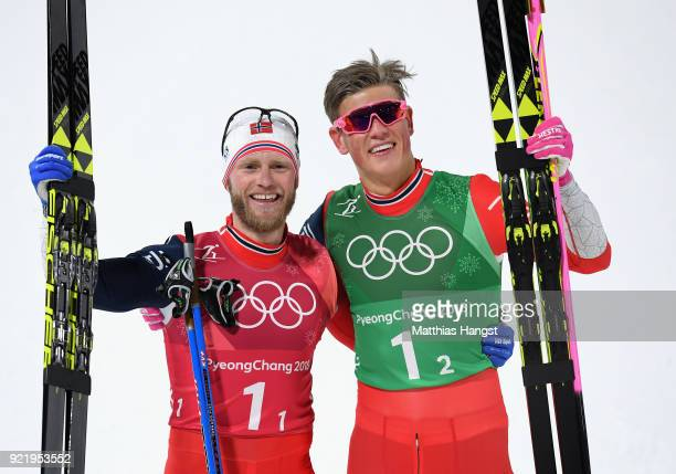 Martin Johnsrud Sundby and Johannes Hoesflat of Norway celebrate winning gold after the Cross Country Men's Team Sprint Free Final on day 12 of the...