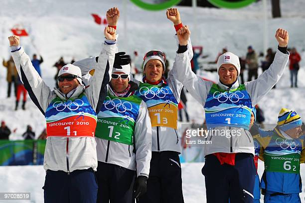 Martin Johnsrud Sundby OddBjoern Hjelmeset Lars Berger and Petter Northug of Norway pose in the flower ceremony after winning the silver during the...