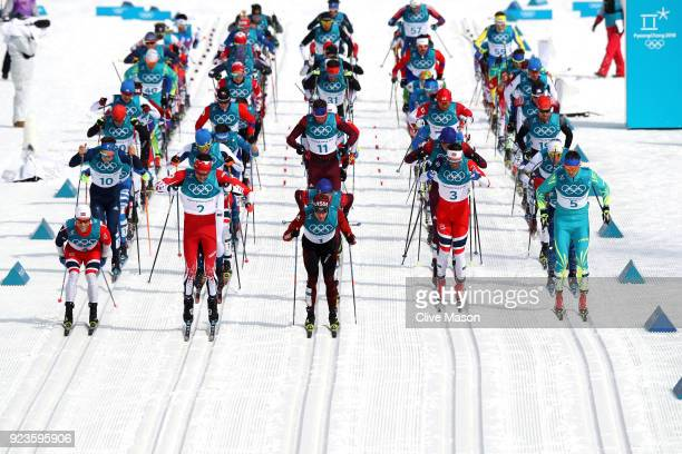 Martin Johnsrud Sundby of Norway Alex Harvey of Canada Dario Cologna of Switzerland Hans Christer Holund of Norway and Alexey Poltoranin of...