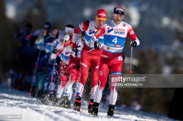 Martin Johnsrud Sundby of Norway and Alexander Bolshunov of Russia compete in the Men's 30km crosscountry skiathlon event at the FIS Nordic Combined...