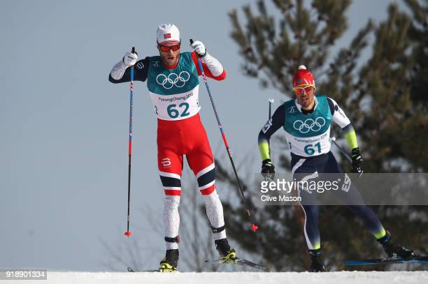 Martin Johnsrud Sundby of Norway and Imanol Rojo of Spain compete during the CrossCountry Skiing Men's 15km Free at Alpensia CrossCountry Centre on...