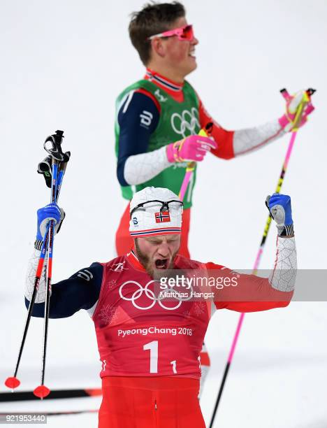 Martin Johnsrud Sundby of Norway celebrates as he wins gold alongside Johannes Hoesflat of Norway during the Cross Country Men's Team Sprint Free...