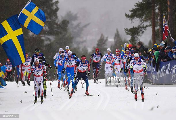 Martin Johnsrud Sundby of Norway Maxim Vylegzhanin of Russia and Johan Olsson of Sweden compete during the Men's 50km Mass Start CrossCountry during...