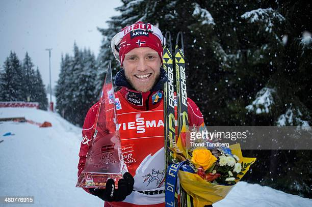 Martin Johnsrud Sundby of Norway poses with the trophy after taking 1st place during the FIS CrossCountry World Cup Tour de Ski Men's 9 km F Final...