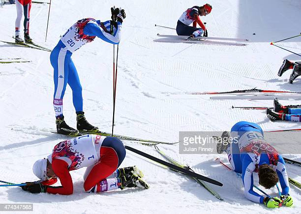 Martin Johnsrud Sundby of Norway Roland Clara of Italy and David Hofer of Italy react after finishing the Men's 50 km Mass Start Free during day 16...
