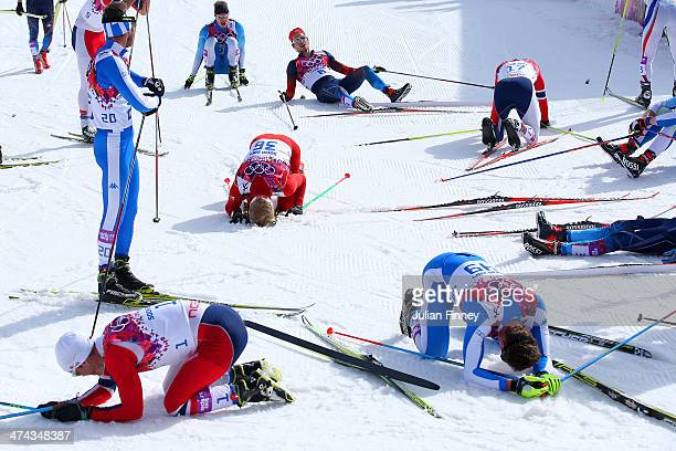 Martin Johnsrud Sundby of Norway Roland Clara of Italy Remo Fischer of Switzerland and David Hofer of Italy react after finishing the Men's 50 km...