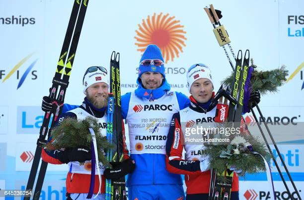 Martin Johnsrud Sundby of Norway Sergey Ustiugov of Russia and Finn Haagen Krogh of Norway pose during the flower ceromeny after the Men's Cross...