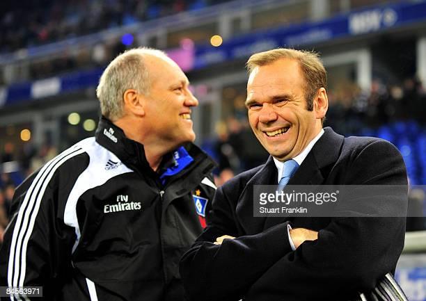 Martin Jol, trainer of Hamburg shares a joke with Bernd Hoffmann, President of Hamburg during the Bundesliga match between Hamburger SV and FC Bayern...