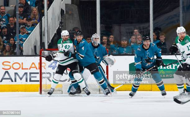 Martin Jones and Brenden Dillon of the San Jose Sharks defend the net against Alexander Radulov of the Dallas Stars at SAP Center on April 3 2018 in...