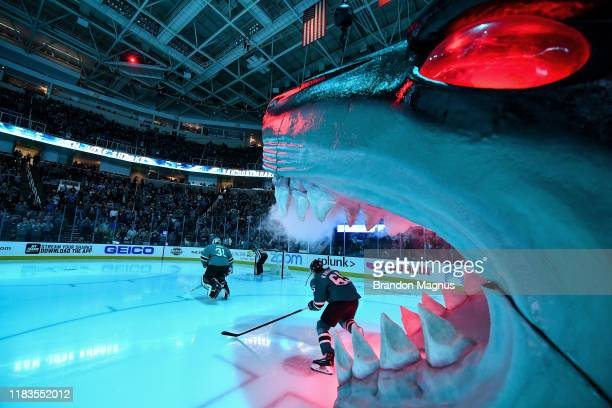 Martin Jones and Erik Karlsson of the San Jose Sharks takes the ice through the Shark Head against the Edmonton Oilers at SAP Center on November 19...