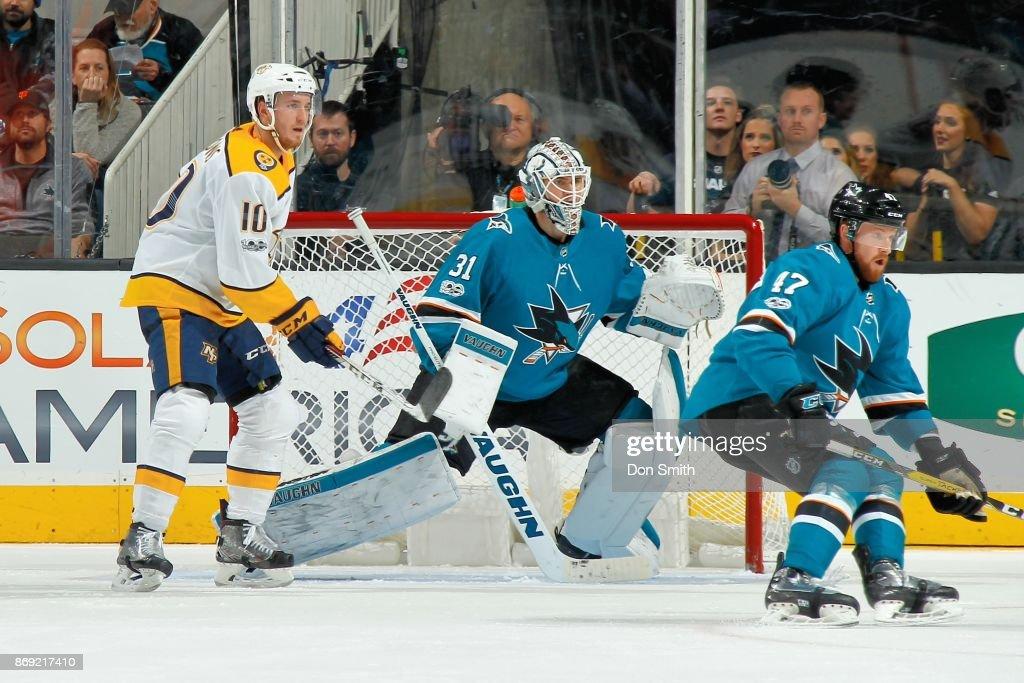 Martin Jones #31 and Joakim Ryan #47 of the San Jose Sharks defend Colton Sissons #10 of the Nashville Predators at SAP Center on November 1, 2017 in San Jose, California.