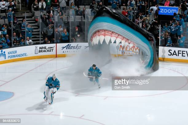 Martin Jones and Joe Pavelski of the San Jose Sharks skate onto the ice before a game against the Minnesota Wild at SAP Center on April 7 2018 in San...