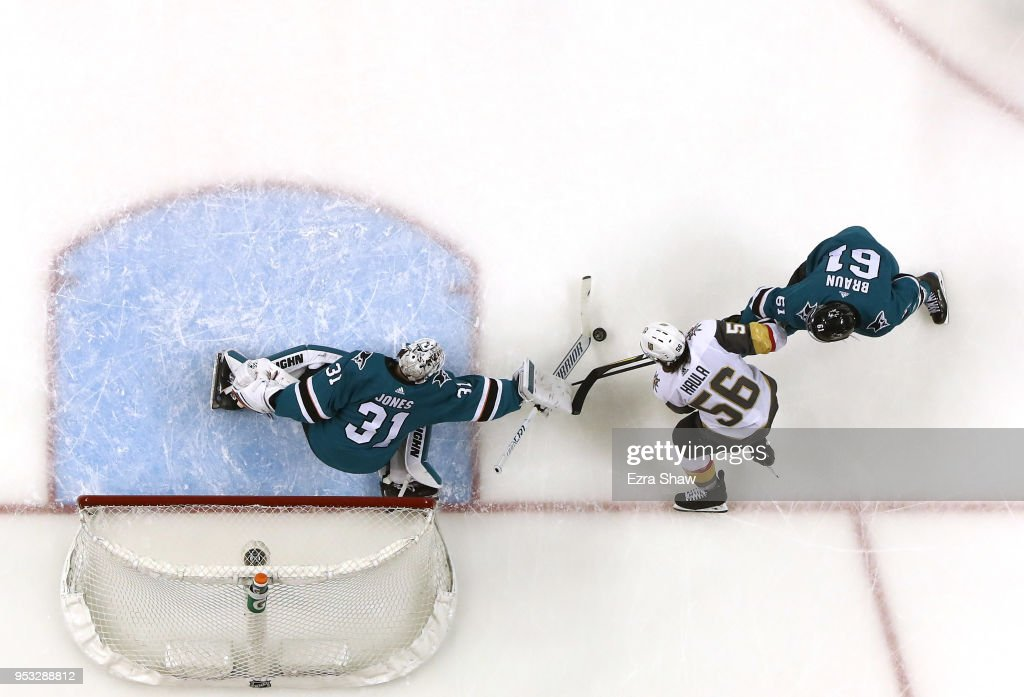 Martin Jones #31 and Justin Braun #61 of the San Jose Sharks stop Erik Haula #56 of the Vegas Golden Knights from scoring during Game Three of the Western Conference Second Round during the 2018 NHL Stanley Cup Playoffs at SAP Center on April 30, 2018 in San Jose, California.
