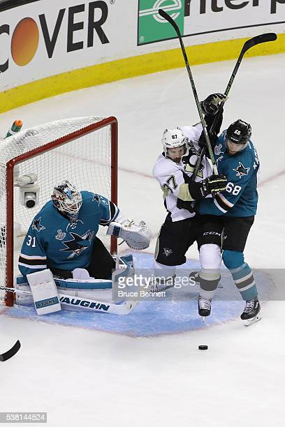 Martin Jones and Melker Karlsson of the San Jose Sharks defend against Sidney Crosby of the Pittsburgh Penguins in Game Three of the 2016 NHL Stanley...