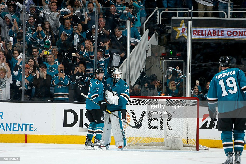 Martin Jones #31 and Paul Martin #7 of the San Jose Sharks celebrate after earning a shut-out win against the Nashville Predators in game seven of the Western Conference Second Round during the 2016 NHL Stanley Cup Playoffs at the SAP Center at San Jose on May 12, 2016 in San Jose, California.