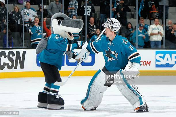 Martin Jones and SJ Sharkie of the San Jose Sharks celebrate the win after a NHL game against the Arizona Coyotes at SAP Center at San Jose on...