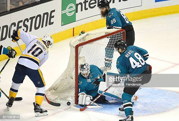 Martin Jones and Tomas Hertl of the San Jose Sharks blocks the shot of Colton Sissons of the Nashville Predators in Game Two of the Western...