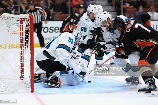 Martin Jones Dylan DeMelo and Danny O'Regan of the San Jose Sharks defend against Andrew Cogliano of the Anaheim Ducks during the third period of a...