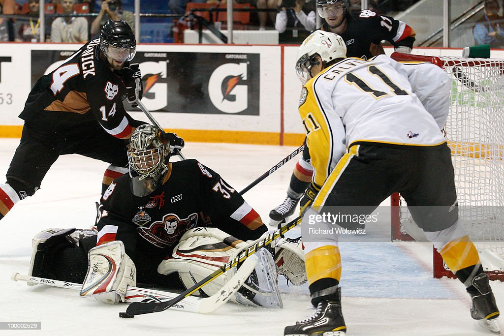 Martin Jones #31 of the Calgary Hitmen gets down to stop the puck on a shot by Matt Calvert #11 of the Brandon Wheat Kings during the 2010 Mastercard Memorial Cup Tournament at the Keystone Centre on May 19, 2010 in Brandon, Manitoba, Canada.