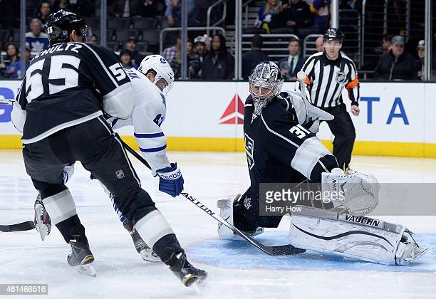 Martin Jones of the Los Angeles Kings makes a save on Tyler Bozak of the Toronto Maple Leafs as Jeff Schultz skates in during the third period of a...