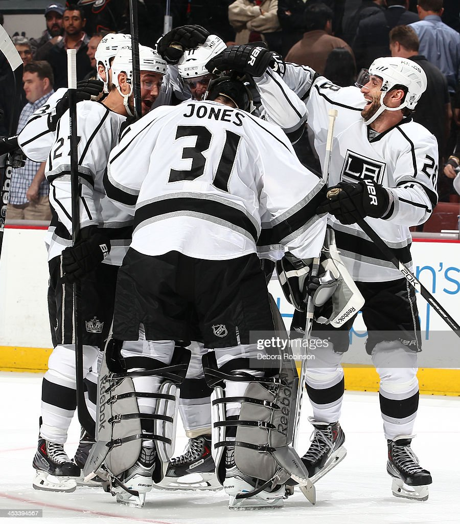 Martin Jones #31 of the Los Angeles Kings, making his NHL debut, is congratulated after the Kings' 3-2 shootout win against the Anaheim Ducks on December 3, 2013 at Honda Center in Anaheim, California.