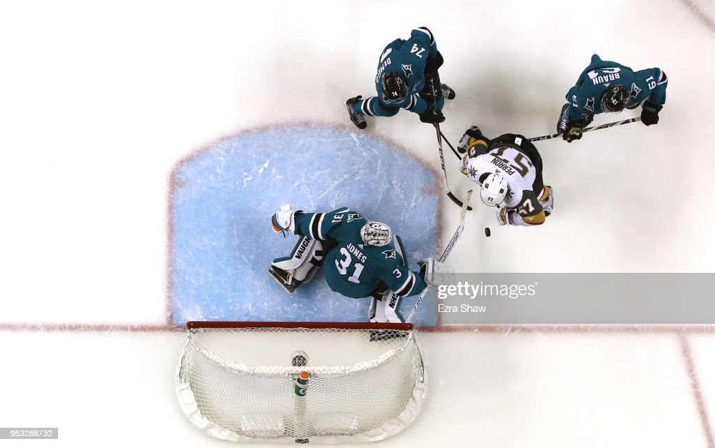 Martin Jones #31 of the San Jose Sharks and Dylan DeMelo #74 and Justin Braun #61 of the San Jose Sharks stop David Perron #57 of the Vegas Golden Knights from scoring during Game Three of the Western Conference Second Round during the 2018 NHL Stanley Cup Playoffs at SAP Center on April 30, 2018 in San Jose, California.