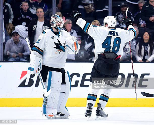 Martin Jones of the San Jose Sharks and Tomas Hertl celebrate a 53 win over the Los Angeles Kings to clinch the series during Game Five of the...