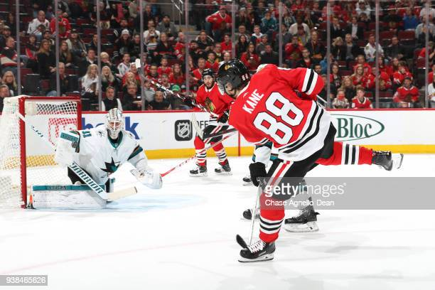 Martin Jones of the San Jose Sharks blocks the shot by Patrick Kane of the Chicago Blackhawks in overtime at the United Center on March 26 2018 in...