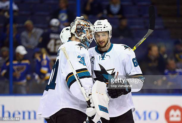 Martin Jones of the San Jose Sharks celebrates with Chris Tierney and Melker Karlsson after defeating the St Louis Blues 40 in Game Two of the...