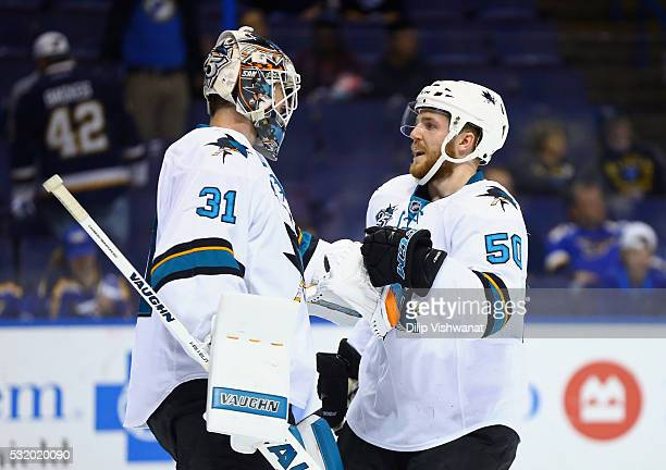 Martin Jones of the San Jose Sharks celebrates with Chris Tierney after defeating the St Louis Blues 40 in Game Two of the Western Conference Final...