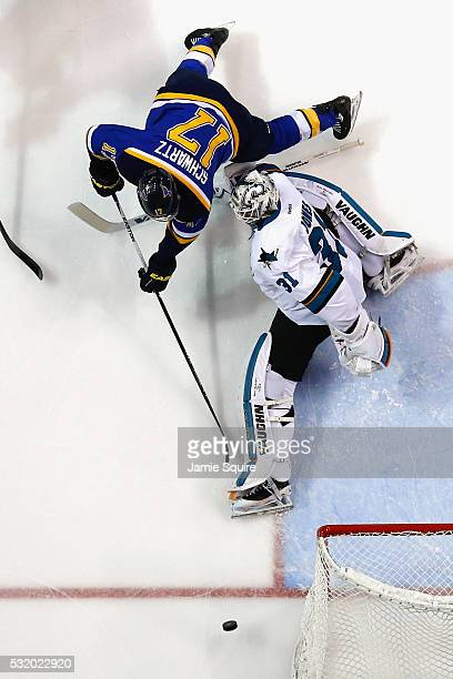 Martin Jones of the San Jose Sharks defends against Jaden Schwartz of the St Louis Blues during the second period in Game Two of the Western...