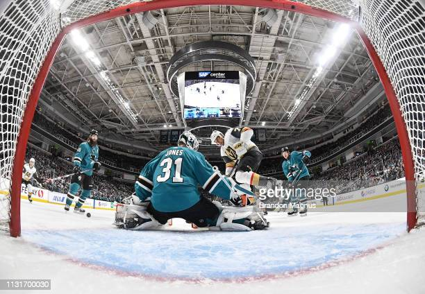 Martin Jones of the San Jose Sharks defends the net against Ryan Reaves of the Vegas Golden Knights at SAP Center on March 18 2019 in San Jose...