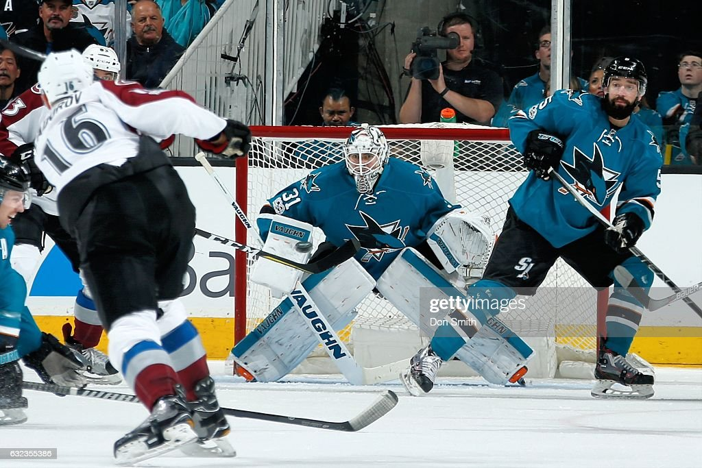 Martin Jones #31 of the San Jose Sharks gets ready to make a save against a puck shot by Nikita Zadorov #16 of the Colorado Avalanche during a NHL game at SAP Center at San Jose on January 21, 2017 in San Jose, California.