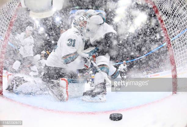 Martin Jones of the San Jose Sharks gives up a goal to Tyler Bozak of the St Louis Blues as Logan Couture of the Sharks defends during the third...