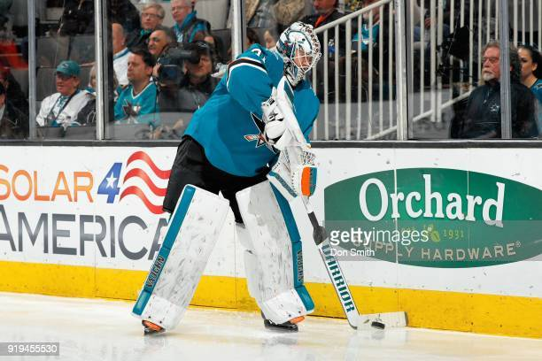 Martin Jones of the San Jose Sharks handles the puck during a NHL game against the Arizona Coyotes at SAP Center on February 13 2018 in San Jose...